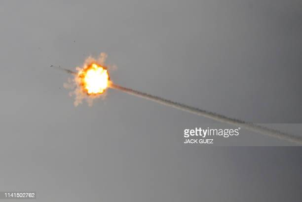 Missile fired from Israel's Iron Dome air defence system intercepts a rocket fired from Gaza on May 5, 2019 along the Israeli-Gaza border.