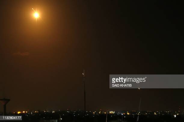 Missile from Israel's Iron Dome air defence system, designed to intercept and destroy incoming short-range rockets and artillery shells, lights the...