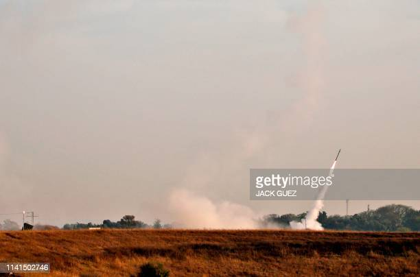 Missile is fired from Israel's Iron Dome air defence system, designed to intercept and destroy incoming short-range rockets and artillery shells,...