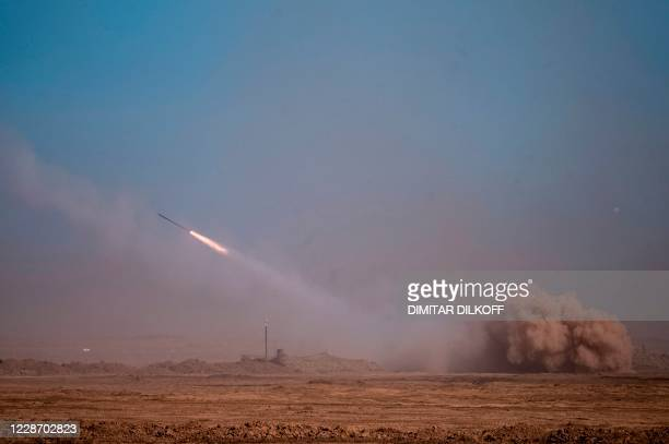 Missile system lunches rockets during military exercises at the Kapustin Yar range in Astrakhan region, Southern Russia on September 25, 2020 during...