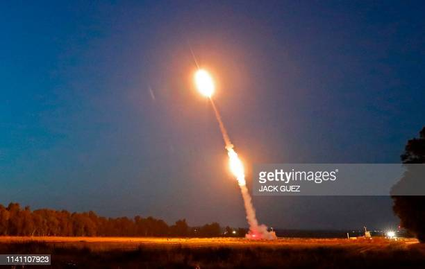 Missiles are fired from Israel's Iron Dome air defence system, designed to intercept and destroy incoming short-range rockets and artillery shells,...