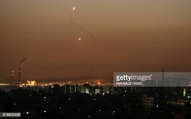 Missiles from the Iron Dome air defence system, designed to intercept and destroy incoming short-range rockets and artillery shells, from a position...