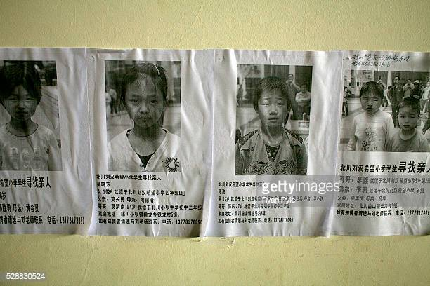 Missing children posters in the Mianyang Football Stadium home to over 20000 homeless earthquake survivors who have arrived over the last week in...