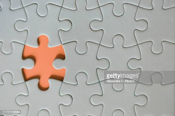 missing jigsaw puzzle piece - conformity stock pictures, royalty-free photos & images