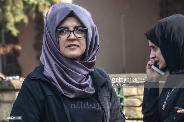 Missing journalist Jamal Khashoggi's Turkish fiancee Hatice and her friend wait in front of the Saudi Arabian consulate in Istanbul on October 3 2018...