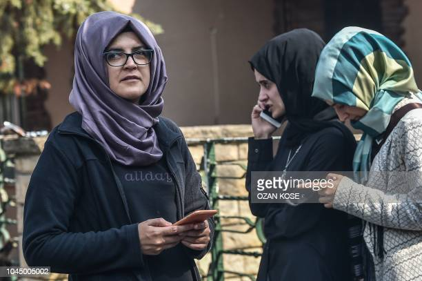 Missing journalist Jamal Khashoggi's Turkish fiancee Hatice and her friends wait in front of the Saudi Arabian consulate in Istanbul on October 3...