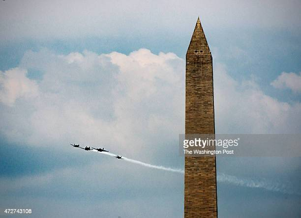 Missing Man formation Curtiss P40 Warhawk Vought F4U Corsair Grumman TBM Avenger and a North American P51 Mustangall World War II planes fly over the...