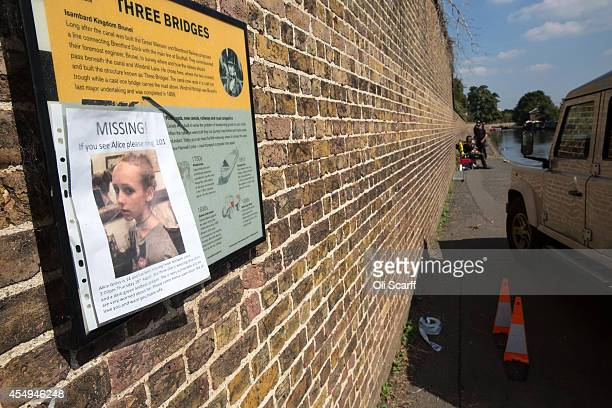 A missing person poster is seen as police divers search a stretch of the Grand Union Canal looking for missing schoolgirl Alice Gross on September 8...