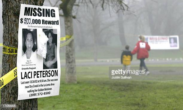 A missing person's poster offering a halfmillion dollar reward for the safe return of Laci Peterson is displayed on a tree at the East La Loma Park...