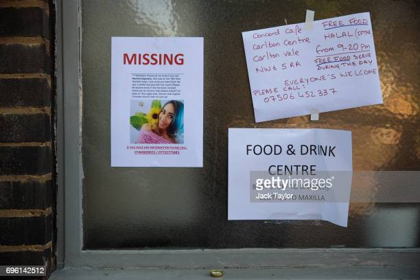 A missing persons poster sits on a community centre near to the site of the Grenfell Tower fire on June 15 2017 in London England At least twelve...
