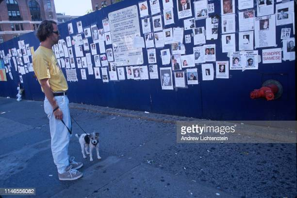 Missing persons posters decorate a construction wall outside of Bellevue Hospital five days after the World Trade Center buildings were attacked by...