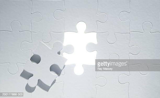 Missing piece on grey jigsaw puzzle, close-up