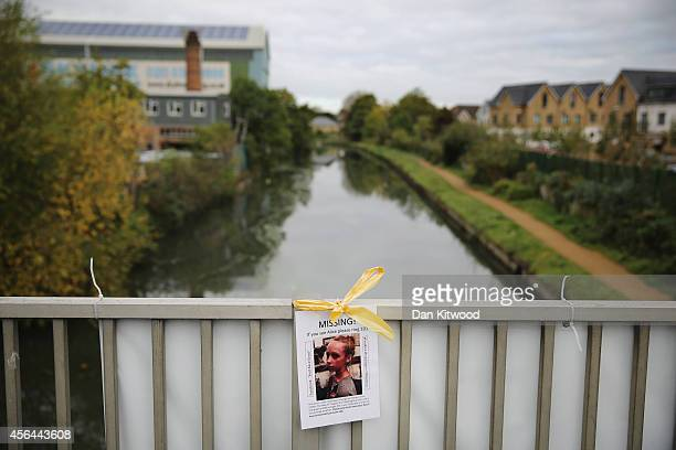 A 'missing' poster of Alice Gross hangs on a bridge over the Grand Union Canal on October 1 2014 in London England The disappearance of teenager...