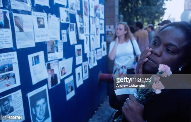Missing posters decorate a construction wall outside of Bellevue Hospital five days after the World Trade Center buildings were attacked by...
