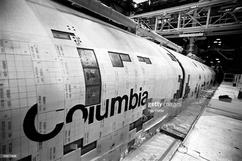 Missing tiles are evident on the space shuttle Columbia I, under construction at Cape Canaveral.