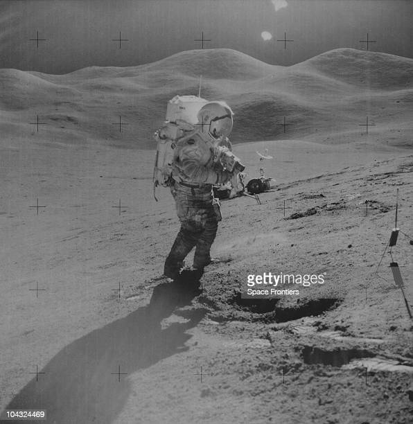 Mission Commander David R Scott uses a 70mm camera on the Hadley Delta during the Apollo 15 lunar landing mission 1971