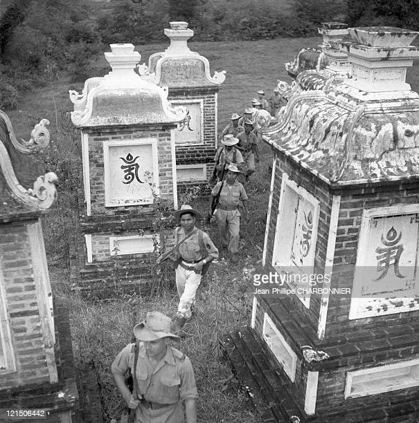 Mission Completed The Patrol Returns To Its Strongpoint And Crosses Through An Indochinese Cemetery Whose Tombs Are Decorated With Funerary Monuments...