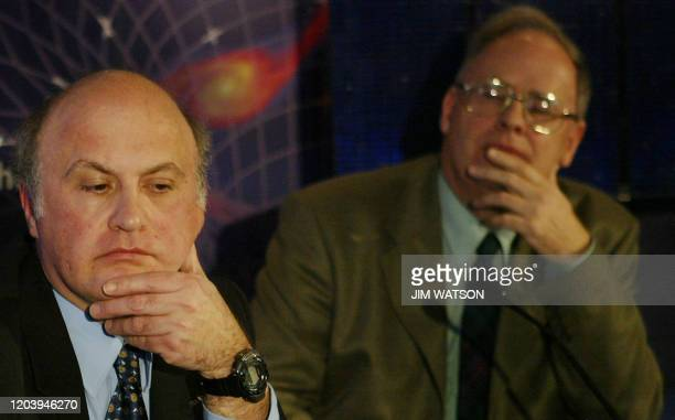 Mission Manager Dr Mark Sim and Ian Morrison of Jodrell Bank listen 26 January 2004 during a press conference on the status of the Beagle 2 Mars...