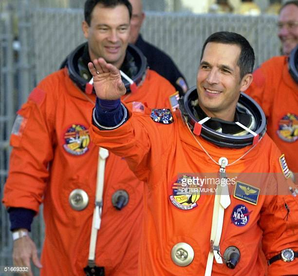 Mission Specialist John Herrington of the US waves before fellow Mission Specialist Michael LopezAlegria of Spain as the crew of the US space shuttle...