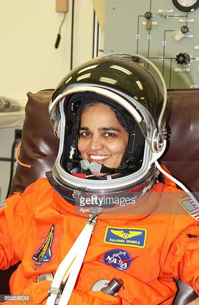 Mission Specialist Kalpana Chawla is helped suiting up for Terminal Countdown Demonstration Test activities which include a simulated launch...