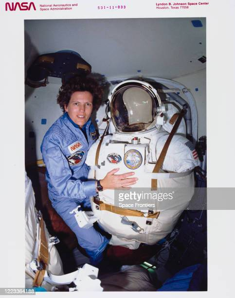 Mission Specialist Kathryn D Sullivan before beginning extravehicular mobility unit donning procedures in the airlock of Space Shuttle Discovery...