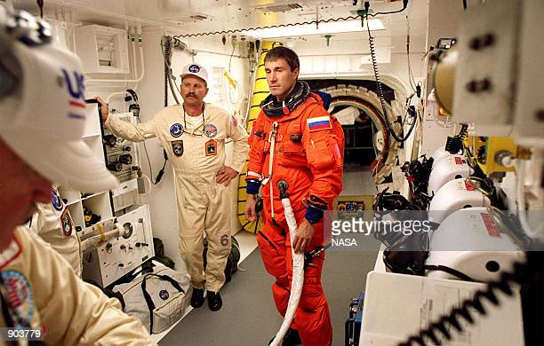 Mission Specialist Sergei Konstantinovich Krikalev a Russian cosmonaut is assisted with his ascent and reentry flight suit in the white room at...