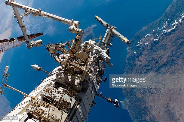 mission specialists translating along the side of one of the station's trusses.  - space shuttle atlantis stock pictures, royalty-free photos & images