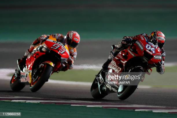 TOPSHOT Mission Winnow Ducati's Italian rider Andrea Dovizioso and Repsol Honda's Spanish rider Marc Marquez compete during the Qatar MotoGP grand...