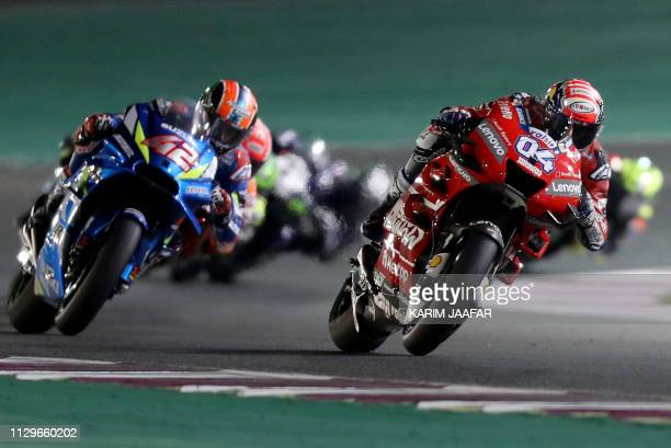TOPSHOT Mission Winnow Ducati's Italian rider Andrea Dovizioso and Suzuki Ecstar's Spanish rider Alex Rins compete during the Qatar MotoGP grand prix...