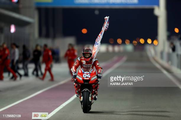 Mission Winnow Ducati's Italian rider Andrea Dovizioso celebrates winning the Qatar MotoGP grand prix at the Losail track in Qatar's capital Doha on...