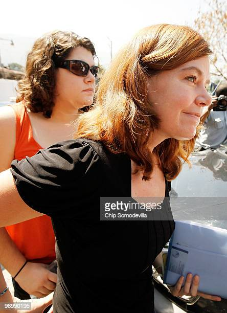 Missionaries Laura Silsby and her livein nanny Charisa Coulter are led inside the main courthourse February 23 2010 in PortauPrince Haiti Silsby the...