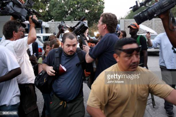 Missionaries released from a Port-au-Prince jail move past the media after a Haitian judge granted them bail and told them they could leave the...