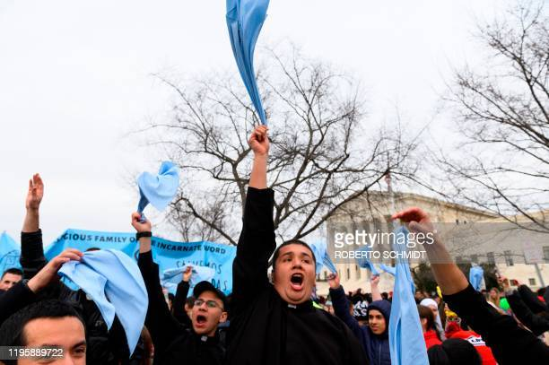 Missionaries shout pro-life slogans as they march past the US Supreme Court building in the 47th annual March For Life in Washington, DC on January...