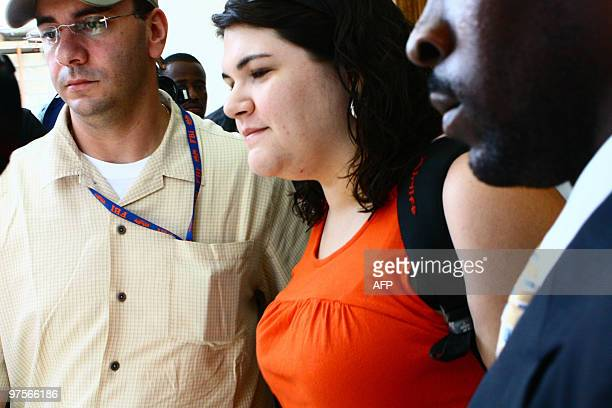 US missionary Charisa Coulter flanked by a US embassy official and her lawyer is freed from a PortauPrince police station Monday March 8 after a...