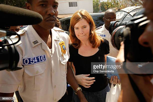 Missionary Laura Silsby is led by police past news photographers outside the main courthourse February 23 2010 in PortauPrince Haiti Silsby the head...