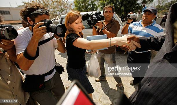Missionary Laura Silsby is led past news photographers by her defense attorney Aviol Fleurant outside the main courthourse February 23 2010 in...