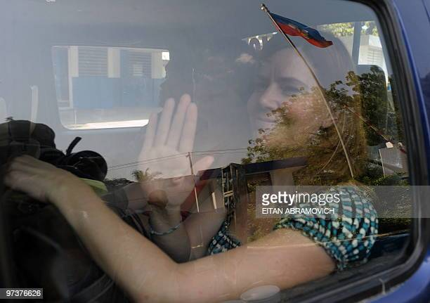 US missionary Laura Silsby waves arrives at a police station in PortauPrince on March 2 2010 Two US missionaries held in Haiti on child abduction...