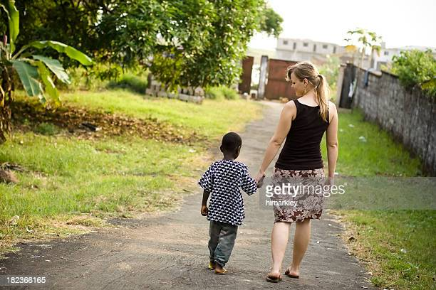 missionary with child - orphan stock pictures, royalty-free photos & images