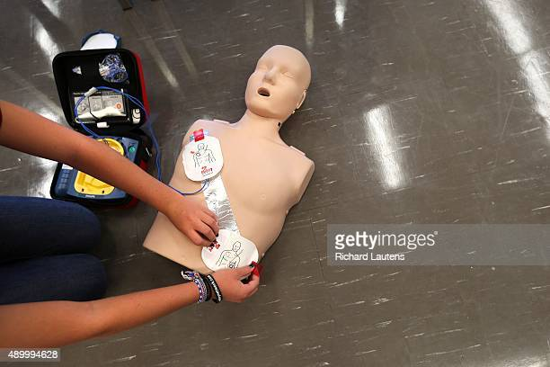 Mississauga Canada September 3 2015 Brianna Kinnaird 15 practices with the defibrillator Clarkson Secondary School students in Mississauga have been...