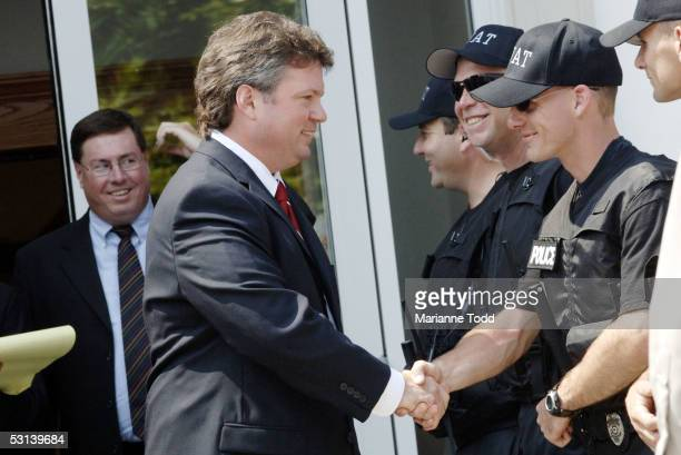 Mississippi Attorney General Jim Hood shakes hands with SWAT team members after Circuit Judge Marcus Gordon gave Edgar Ray Killen three consecutive...