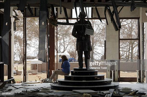 Mississippi First Lady Marsha Barbour sits among the ruins of the Jefferson Davis Library while making calls for help to the historic property...