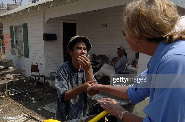 Mississippi First Lady Marsha Barbour talks with Hurricane Katrina victim Thanh Tran who was injured swimming in Katrina's surge and debris at his...