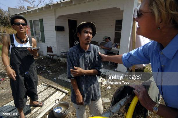 Mississippi First Lady Marsha Barbour talks with Hurricane Katrina victims Thanh Tran who was injured swimming in Katrina's surge and debri and Tony...