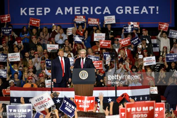 """Mississippi Governor Phil Bryant, right, speaks alongside President Donald Trump during a """"Keep America Great"""" campaign rally at BancorpSouth Arena..."""