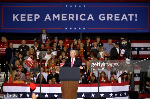 """Mississippi Governor Phil Bryant speaks during a """"Keep America Great"""" campaign rally featuring President Donald Trump at BancorpSouth Arena on..."""