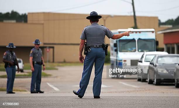 Mississippi Highway Patrol officer directs traffic following a memorial service honoring slain Hattiesburg Mississippi police officers Benjamin Deen...