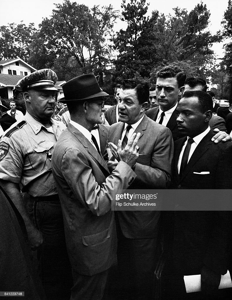 Mississippi Lieutenant Governor Paul Johnson blocks James Meredith, U.S. Marshal J.P. McShane, and Justice Department attorney John Doar from entering the University of Mississippi campus. Meredith became the first black student to enroll.