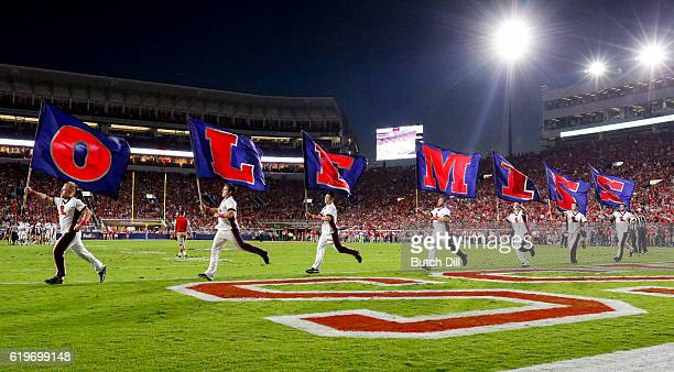 Mississippi Rebels cheerleaders celebrate after a touchdown during the 2nd half of an NCAA college football game against the Auburn Tigers on October...