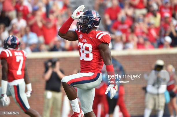 Mississippi Rebels defensive end Marquis Haynes throws up the 'Land Shark' gesture after a defensive play during the second quarter of a college...