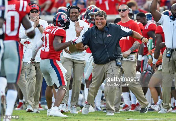 Mississippi Rebels interim coach Matt Luke celebrates with one of his defensive players after a missed Vanderbilt Commodore field goal during the...